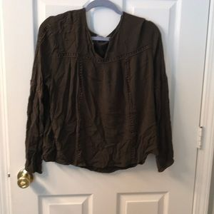An olive long sleeve blouse